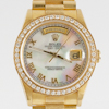 Ladies Rolex. Mother of Pearl and Roman Numeral Dial. Diamond bezel.